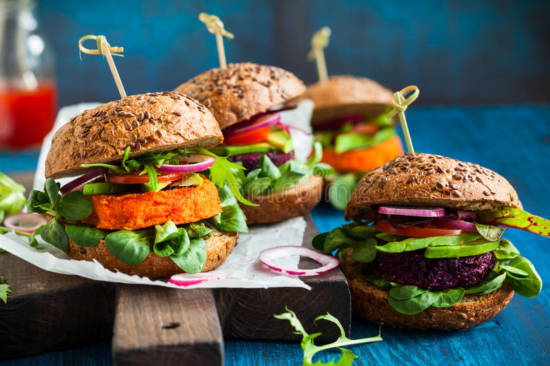 Veggie beet and carrot burgers. With avocado stock photography