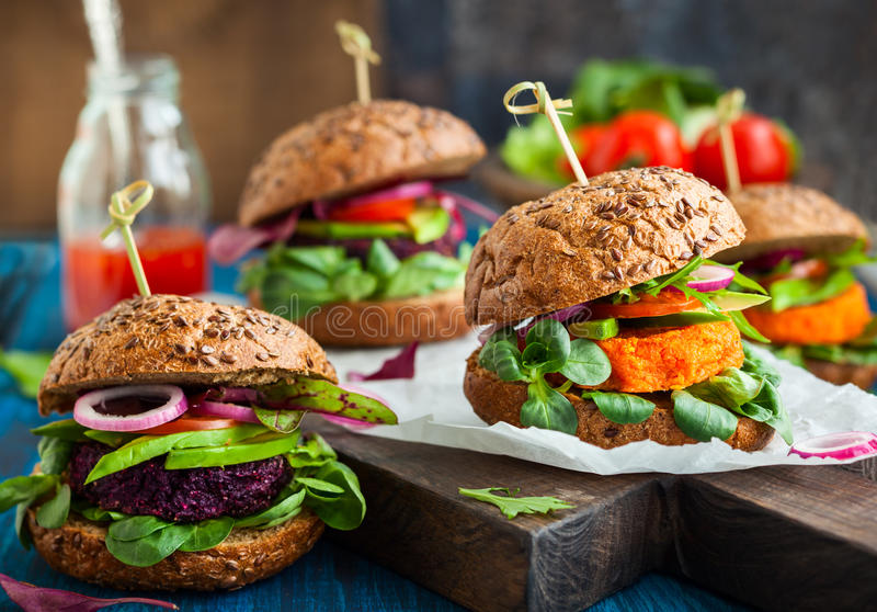 Veggie beet and carrot burgers. With avocado stock images