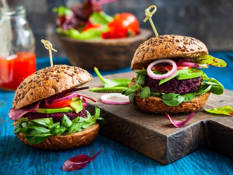 Veggie beet and quinoa burger. With avocado royalty free stock photos