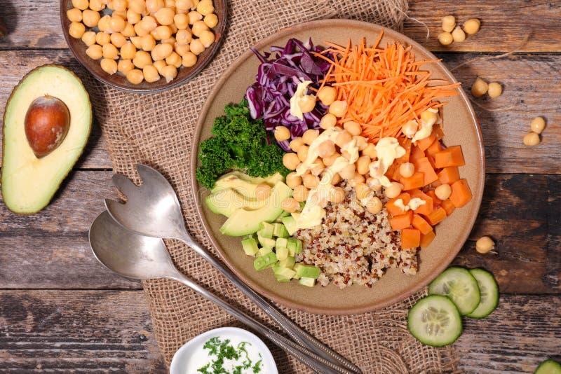 Veggie bowl. On wood background stock image