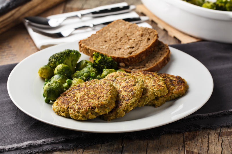 Veggie burger. Homemade veggie burgers with roasted vegetables and bread stock images
