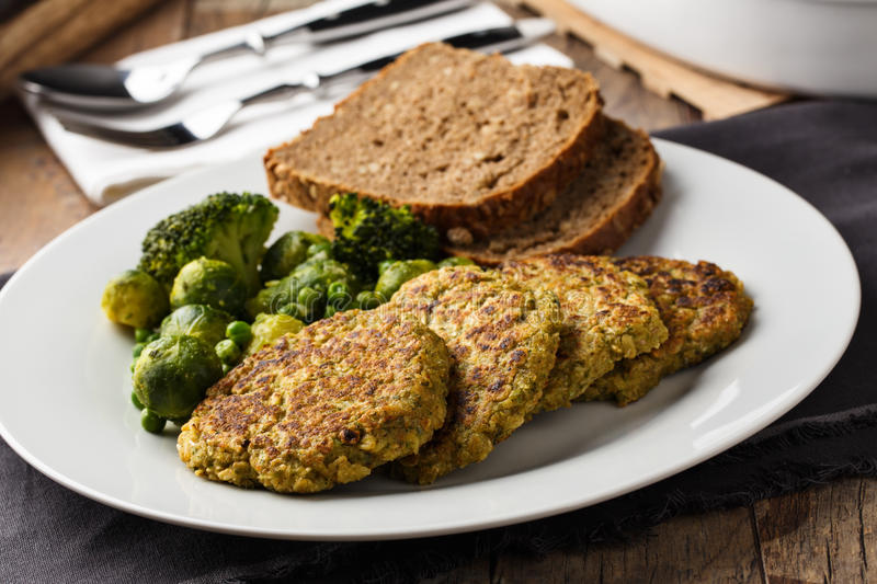 Veggie burger. Homemade veggie burgers with roasted vegetables and bread royalty free stock image