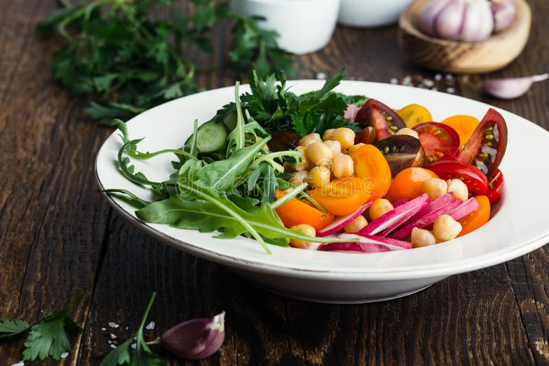 Veggie chickpeas salad with fresh vegetables and herbs, plant based meal stock photos
