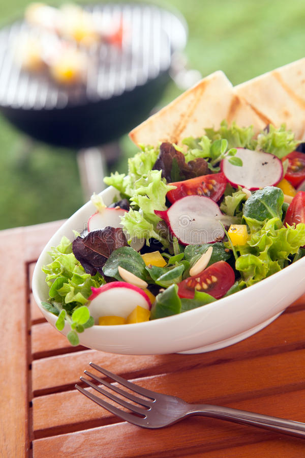 Veggie Healthy fresh vegetarian salad on a picnic table royalty free stock photography