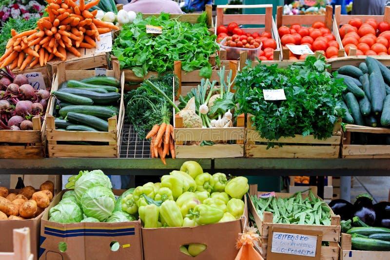 Veggie market. Fresh and organic vegetables at farmers market royalty free stock photos