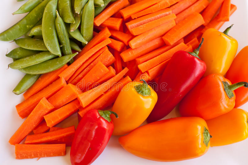 Veggie platter. Bright and colorful veggie platter with peppers, carrots, and snap peas royalty free stock photography
