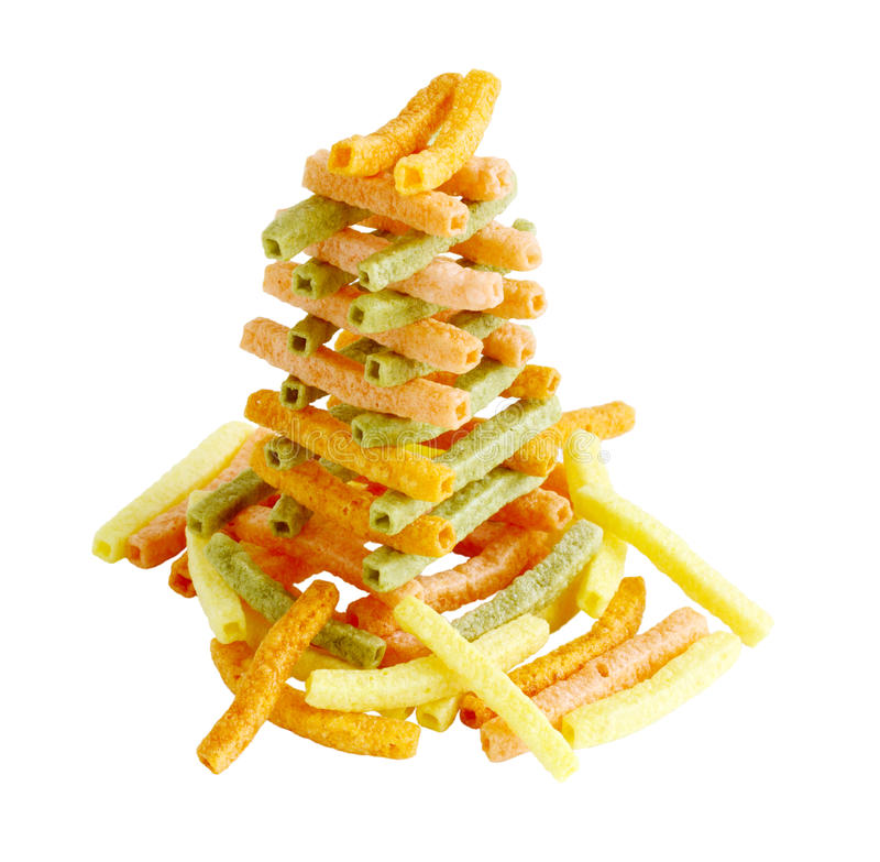 Veggie Straw Tower. Colorful veggie straw tower isolated on white background royalty free stock photography