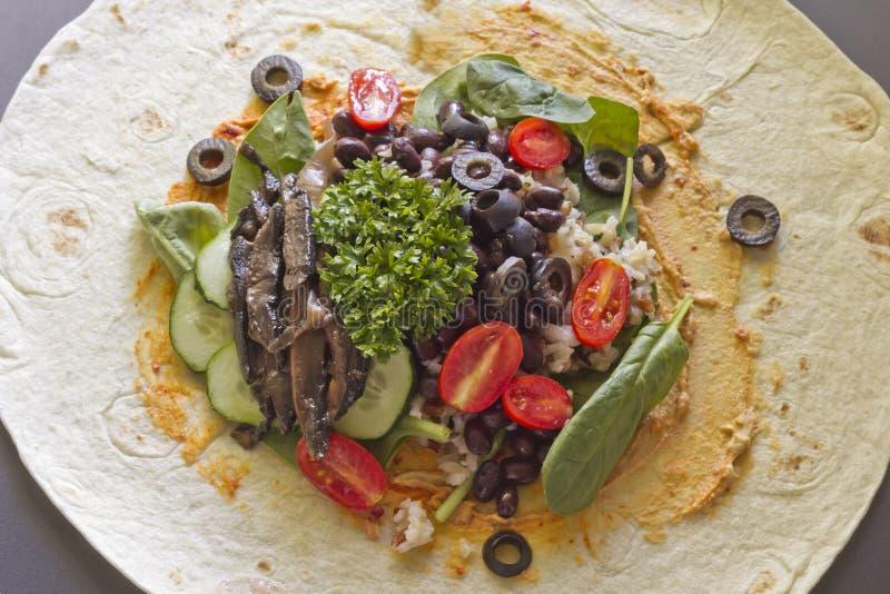 Veggie Wrap. Portobello mushroom organic veggie vegan wrap open to show ingredients stock photo