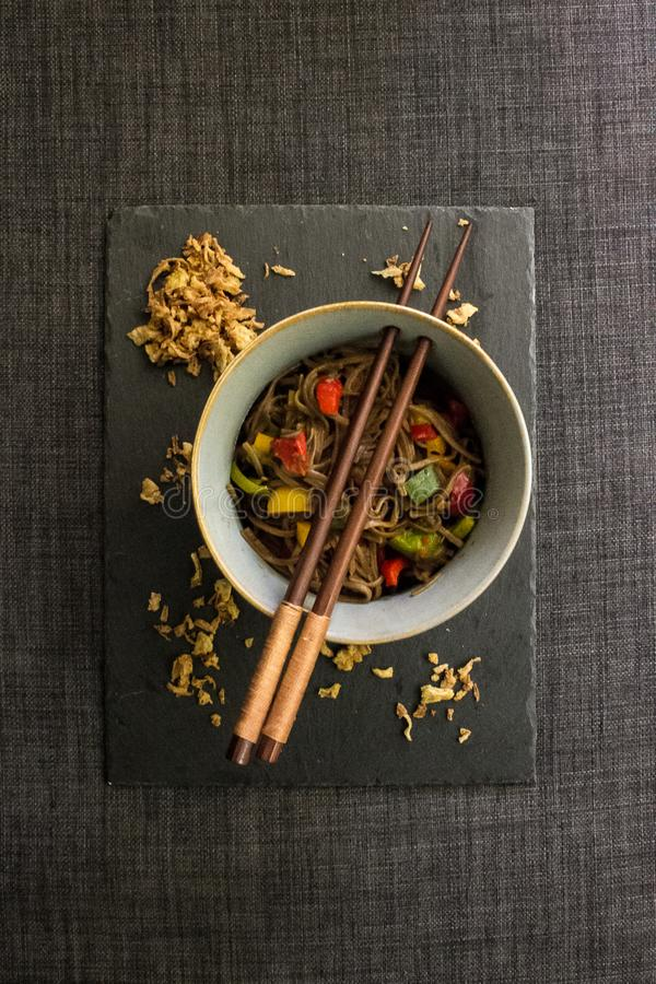 Veggie yakisoba in flat lay composition stock images
