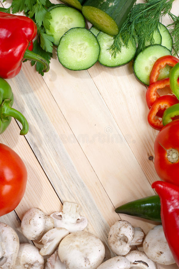 Veggies on Table top. Overhead shot of fresh veggies around the corners of the frame with empty space for your text in the middle royalty free stock photos