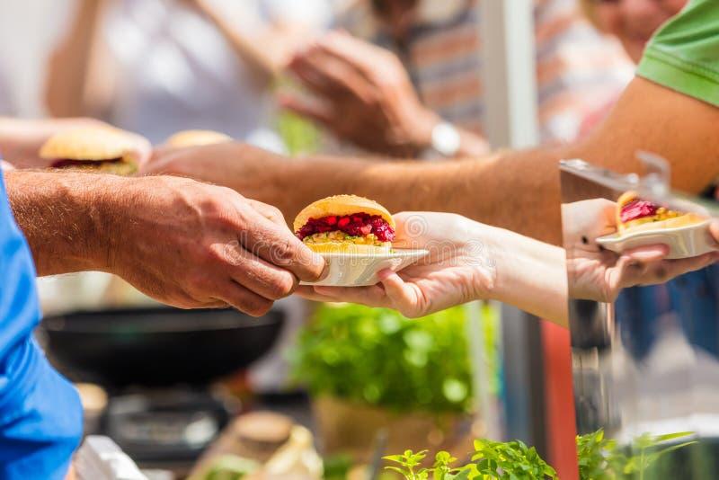 Vegitarian Burger on street food Festival royalty free stock image