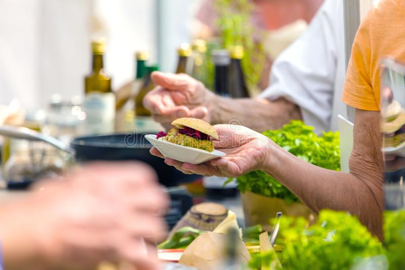 Vegitarian Burger on street food Festival royalty free stock photography