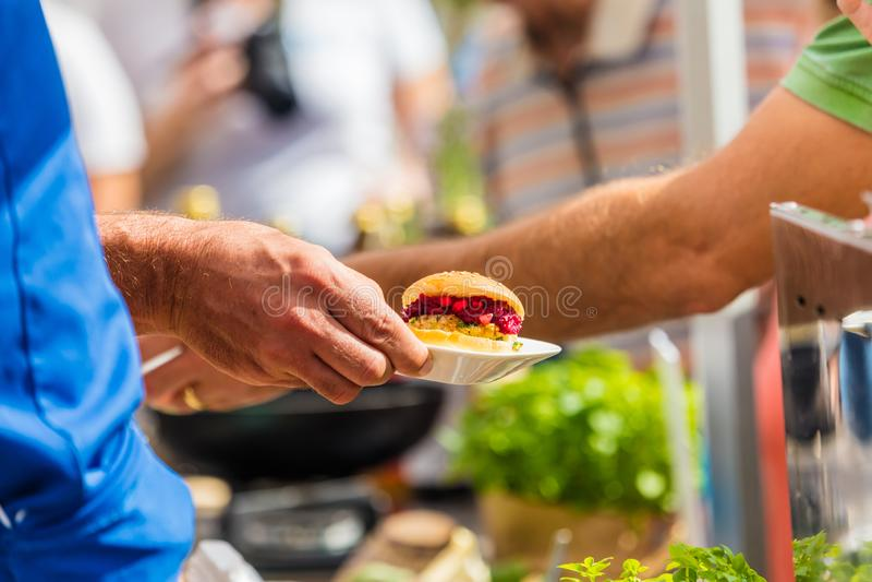 Vegitarian Burger on street food Festival stock photography