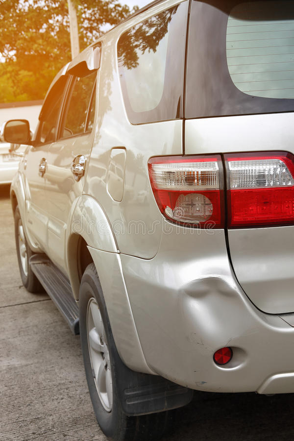 Vehicle car bumper dent and taillight broken collision crash. Damage accident on road stock photography