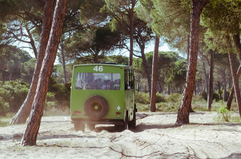 Vehicle, in the dunes of a andalusian national park, Spain. Background, scenic, tranquil, sand, freedom, travel, dry, grass, grained, sandy, summer, tourism stock images