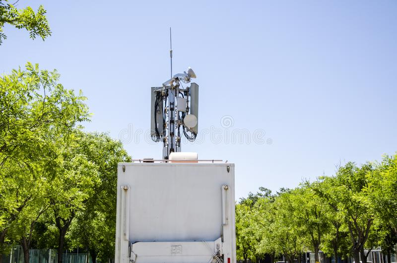 Vehicle Emergency Mobile Communication. The fifth generation mobile communication vehicle emergency system is composed of lifting tower, digital microwave stock photo