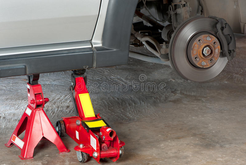Vehicle on jack stand stock photography