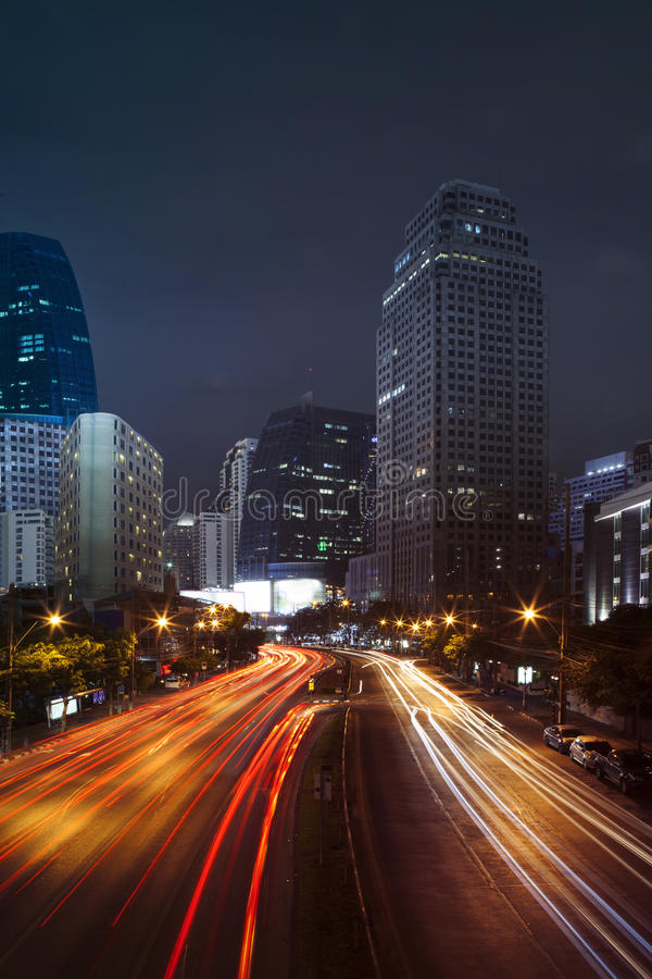 Vehicle lighting on urban road and building against night scene royalty free stock photos