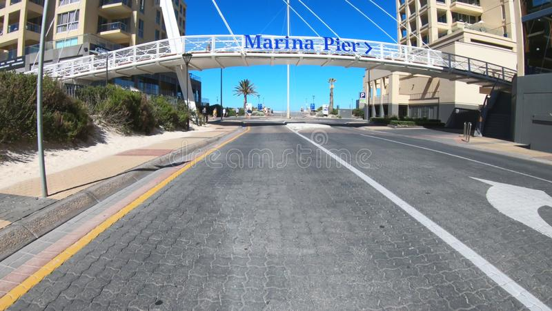 Vehicle POV driving thrpugh to the Glenelg Marina Pier, South Australia. stock photos