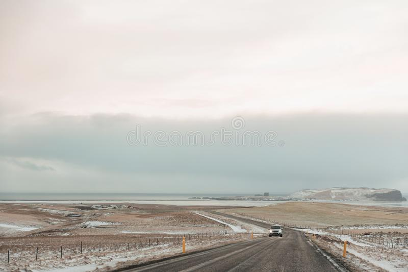 Vehicle on road and beautiful snow-covered. Icelandic landscape stock photo