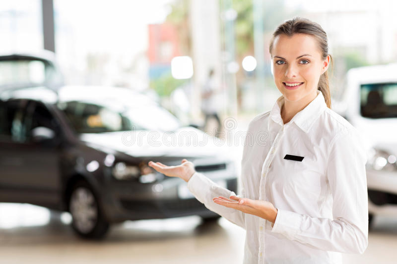 Vehicle sales consultant presenting stock images