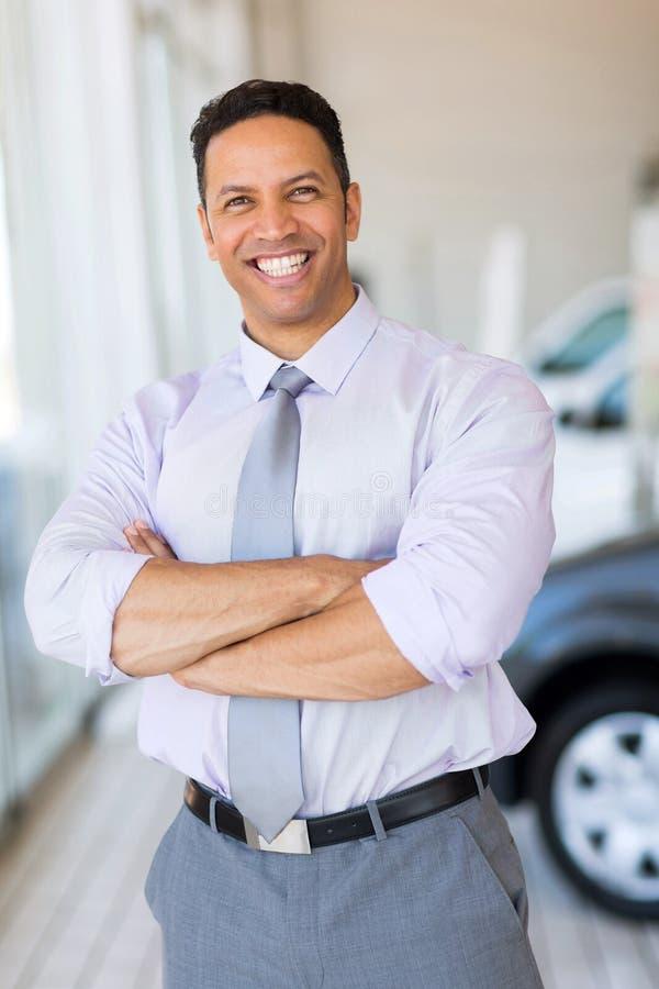 vehicle salesman showroom stock photo image of confident 51012332. Black Bedroom Furniture Sets. Home Design Ideas