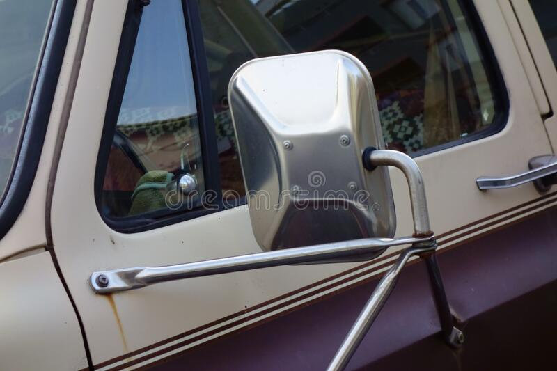 Vehicle side mirror. Rugged, antique, retro vehicle side mirror royalty free stock photos