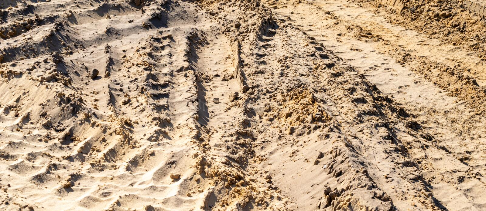 Vehicle tracks on yellow sand. Texture or background.  stock photography