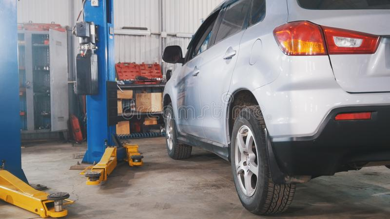 Vehicle workshop - white car in car service station. Wide angle stock photography