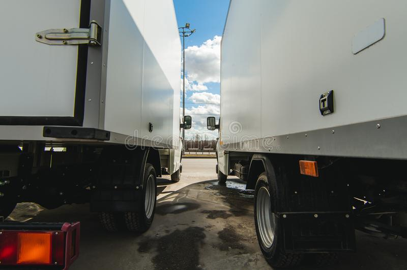 vehicles for cargo transportation business. trucks small and medium-duty trucks. new working cars cargo vans of white color stock image