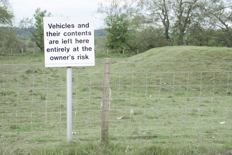 Vehicles and contents left at owners risk sign post responsibility theft loss damage at remote rural countryside national park stock photography