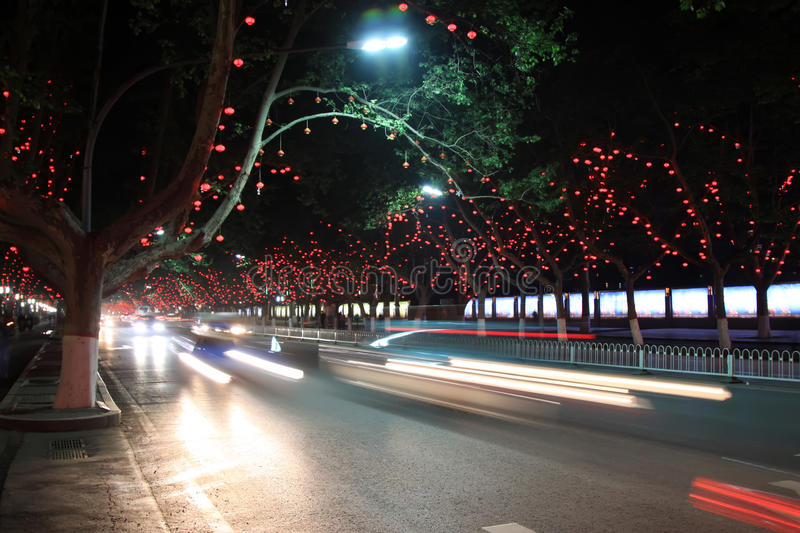 Vehicles And Light, Trees In The Modern City, In The Night Royalty Free Stock Photo