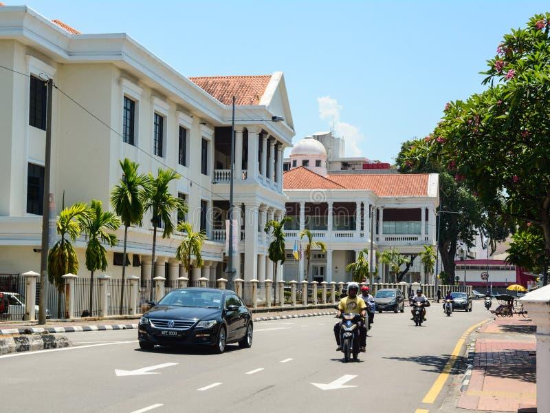 Vehicles run on street at Chinatown in Penang, Malaysia royalty free stock image