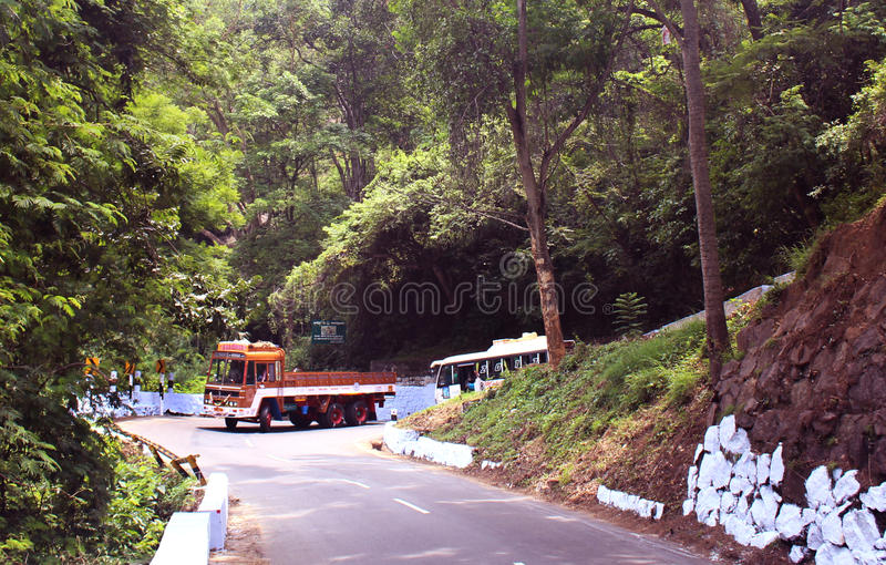 Vehicles on the uphill road royalty free stock photo