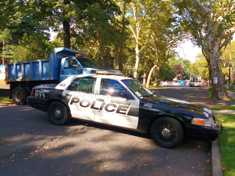 Police Car Blocking the Road, Protecting the Labor Day Street Fair, Rutherford, NJ, USA stock photography
