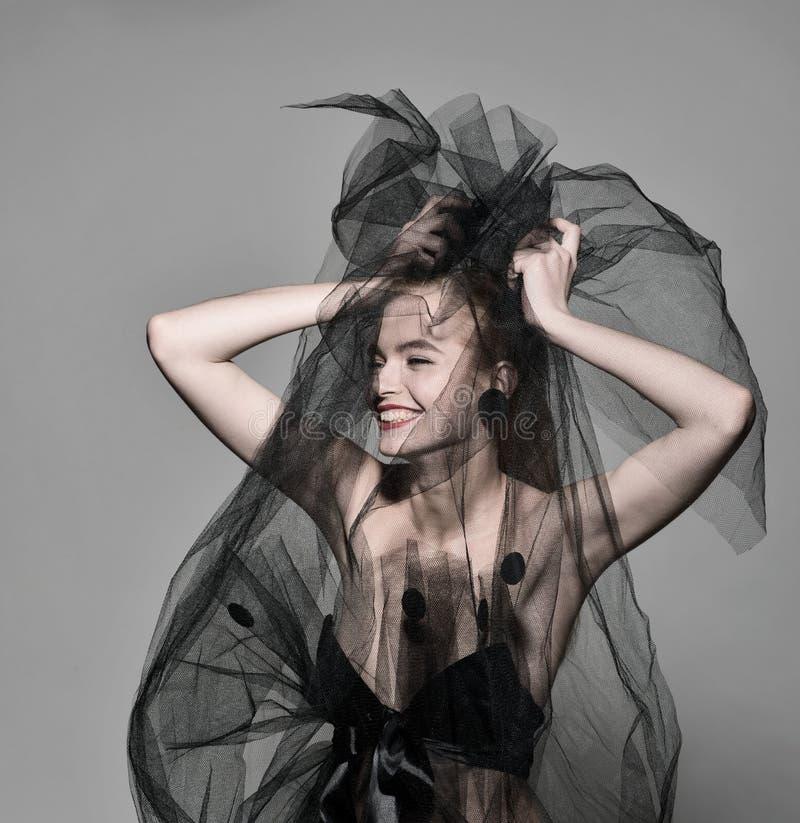 Veil fashion woman art vogue photo red lips. Professional beauty model face stock photo
