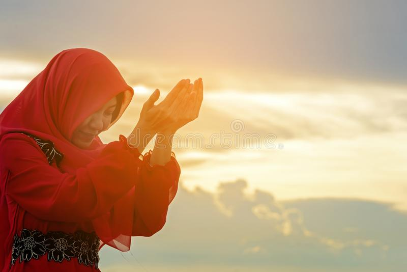 Veiled Islamic muslim woman wearing a burka standing royalty free stock images