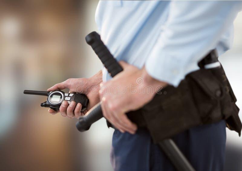 veiligheidsagent met walkie-talkie Terug vaag stock afbeelding