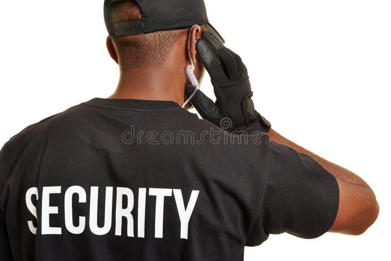 Veiligheidsagent van erachter stock foto