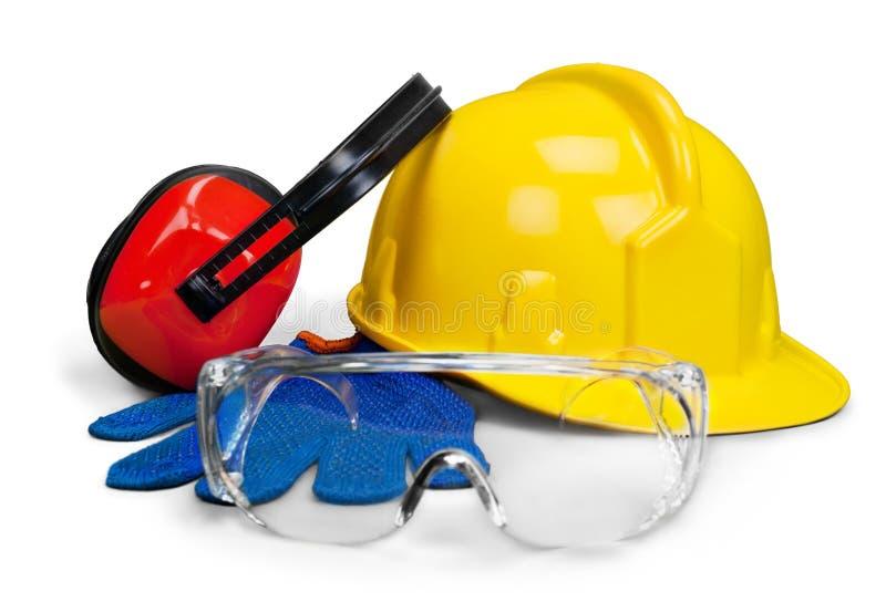 Veiligheidsmateriaal - bouwvakker, beschermende bril, handschoenen en oog royalty-vrije stock afbeelding