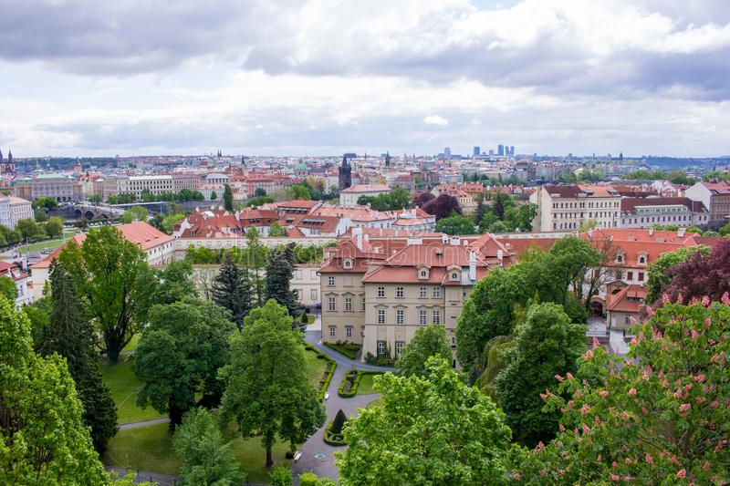 """Veiw of Prague city from above. Prague, capital city of the Czech Republic, is bisected by the Vltava River. Nicknamed """"the City of a Hundred Spires stock photo"""