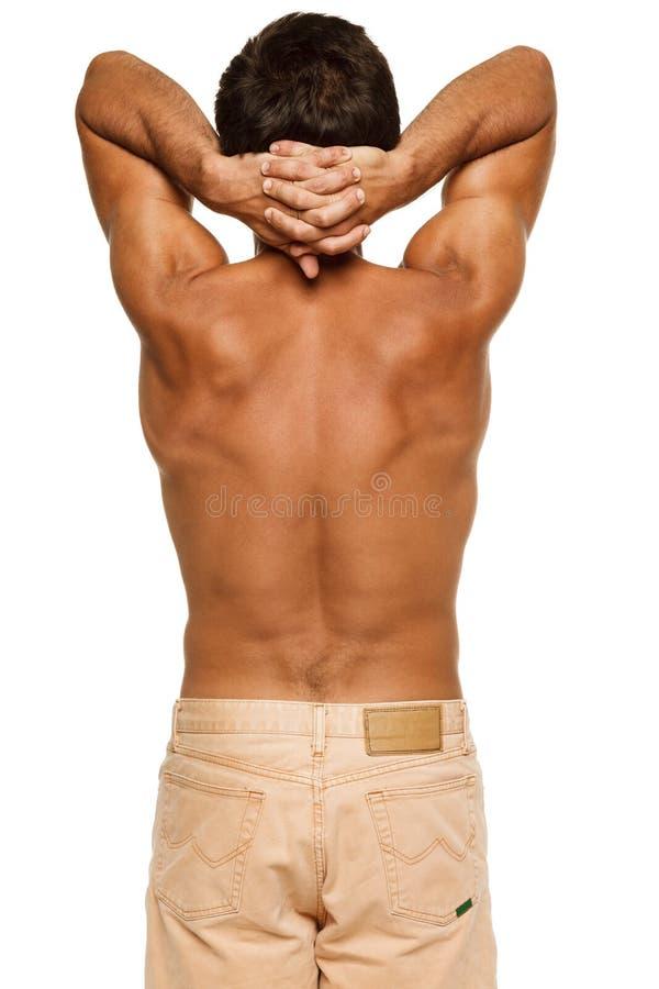 Veiw traseiro do homem atlético imagens de stock