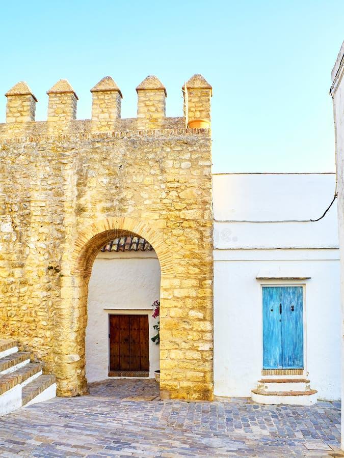 Vejer de la Frontera downtown. Cadiz province, Andalusia, Spain. Arch of the Closed Door, Arco de la Puerta Cerrada, in the Jewish quarter of Vejer de la stock image