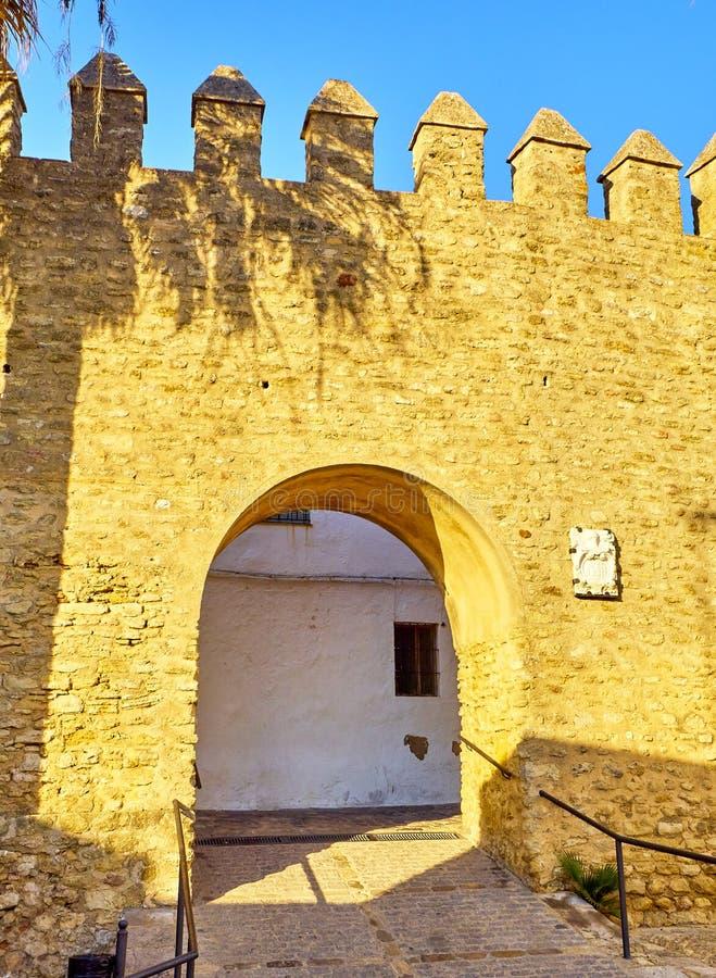 Vejer de la Frontera downtown. Cadiz province, Andalusia, Spain. Arch of the Closed Door, Arco de la Puerta Cerrada, in the Jewish quarter of Vejer de la royalty free stock images