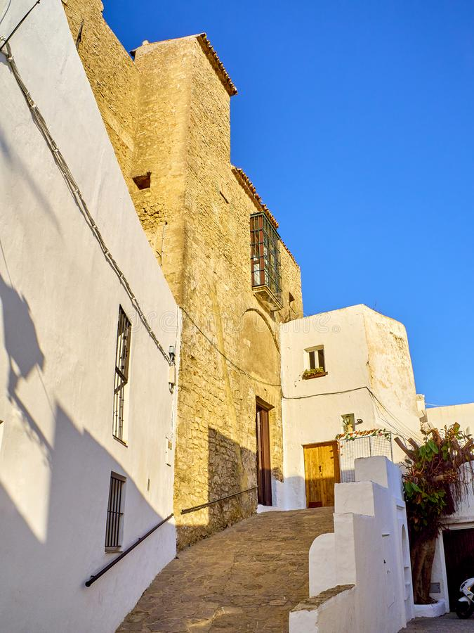 Vejer de la Frontera downtown. Cadiz province, Andalusia, Spain. Vejer de la Frontera Castle, entry of the Jewish quarter. View from the Calle del Castillo stock images
