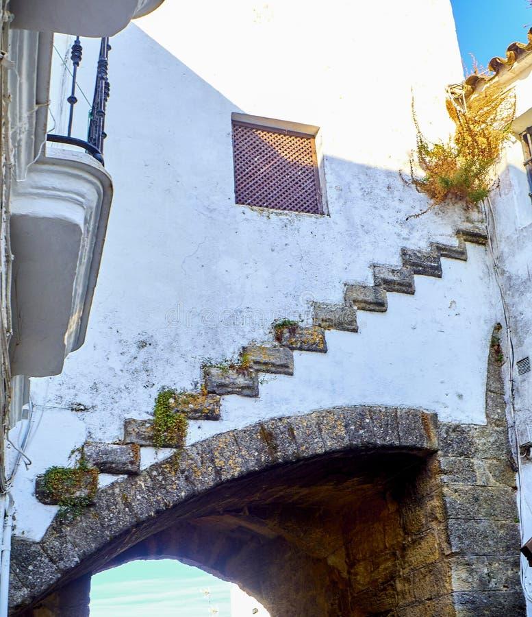 Vejer de la Frontera downtown. Cadiz province, Andalusia, Spain. Detail of the Arch of La Segur, Arco de La Segur, in the Marques de Tamaron street. Vejer de la stock image