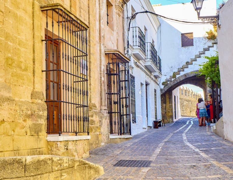 Vejer de la Frontera downtown. Cadiz province, Andalusia, Spain. Vejer de la Frontera, Spain - June 26, 2019. Arch of La Segur, Arco de La Segur, in the Marques royalty free stock image
