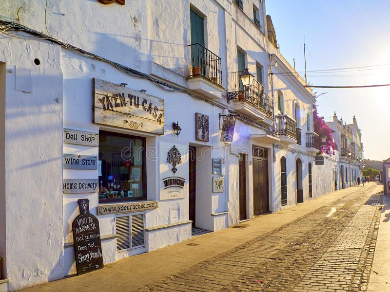 Vejer de la Frontera downtown. Cadiz province, Andalusia, Spain. Vejer de la Frontera, Spain - June 26, 2019. La Corredera walkway at sunset, a typical street of royalty free stock image