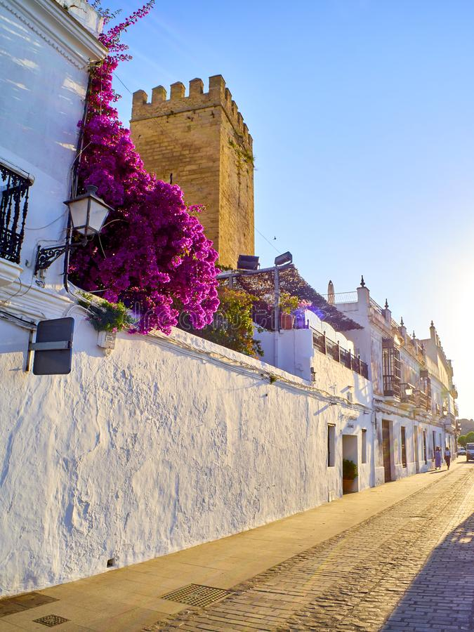 Vejer de la Frontera downtown. Cadiz province, Andalusia, Spain. Vejer de la Frontera, Spain - June 26, 2019. La Corredera walkway at sunset, a typical street of stock photos
