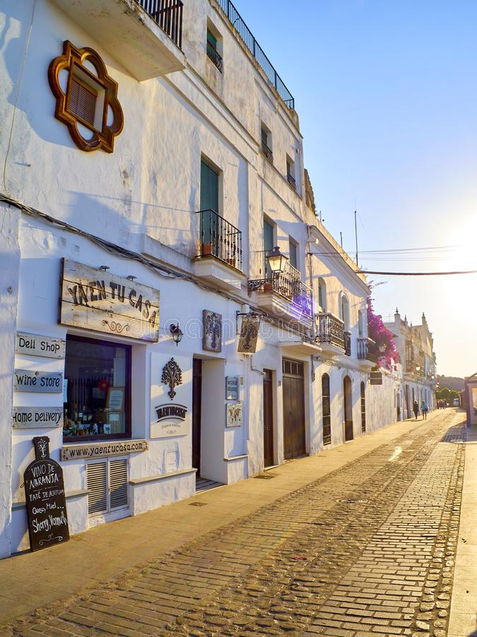 Vejer de la Frontera downtown. Cadiz province, Andalusia, Spain. Vejer de la Frontera, Spain - June 26, 2019. La Corredera walkway at sunset, a typical street of stock image